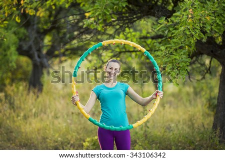 Girl practicing with hula hoop on nature