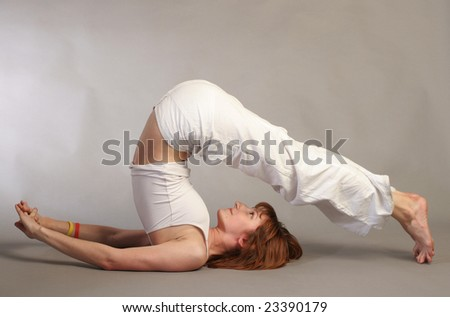 girl practicing yoga - stock photo