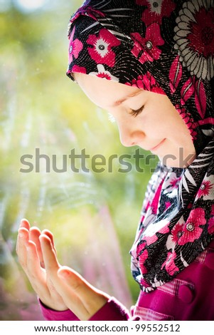 Girl praying - stock photo
