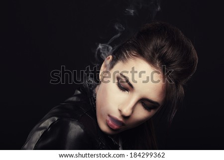 Girl producing cigarette smoke
