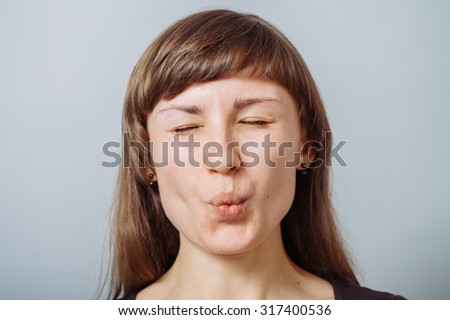 girl pulled a cheek - stock photo