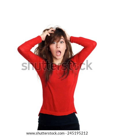 Girl pulling her hair making a crazy gesture on white background - stock photo