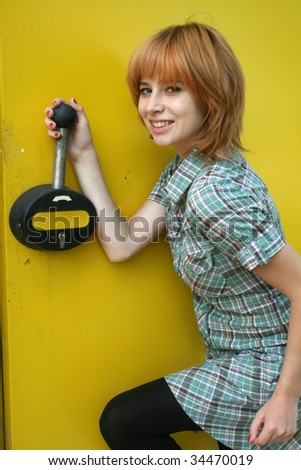 Girl pulling lever - stock photo