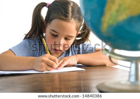 girl pupil sitting by the table with globe Isolated on white - stock photo