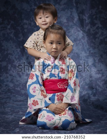 Girl Putting Her Hand On The Shoulder Of Her Sister Wearing Yukata