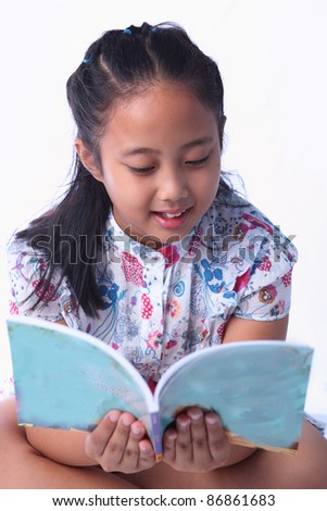girl reading a book isolated white - stock photo