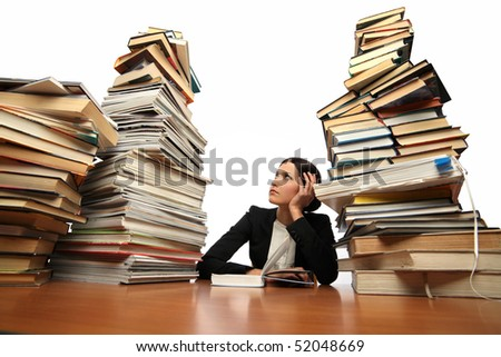girl reading a book (many books on the table)