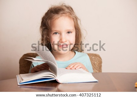 Girl reading book. Child education - stock photo
