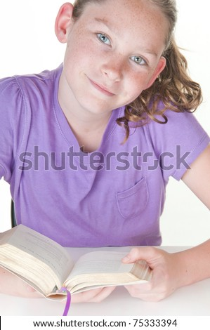 girl reading book looking happy - stock photo