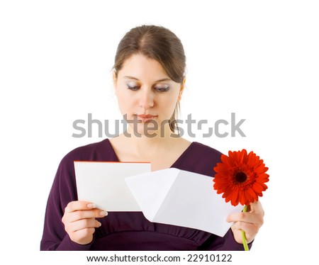 girl reading Valentine card and holding red flower - stock photo