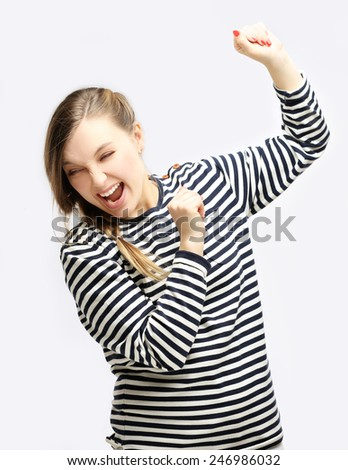 Girl rearing back from physical abuse raising her hands to shield herself. - stock photo