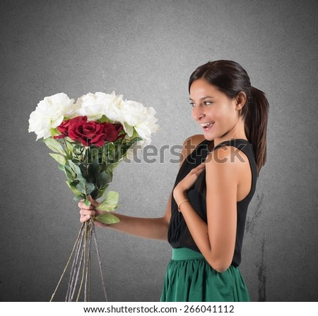 Girl receives a gift of flowers unexpected - stock photo