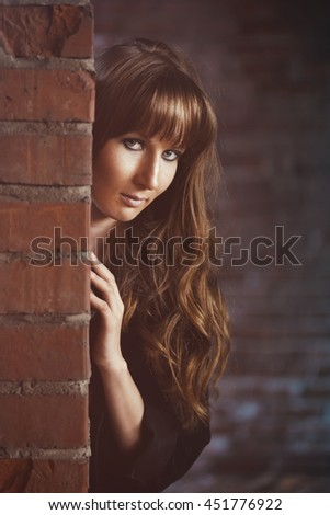 Girl recline on the brick wall - stock photo