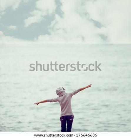 girl relax music ashore - stock photo