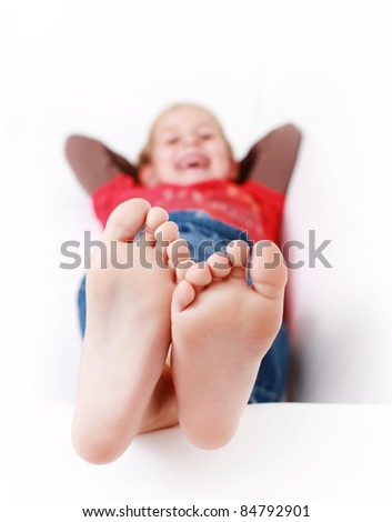 Girl relaxing and smiling on the couch - stock photo