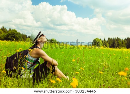 Girl relaxing in a field enjoying nature.  - stock photo
