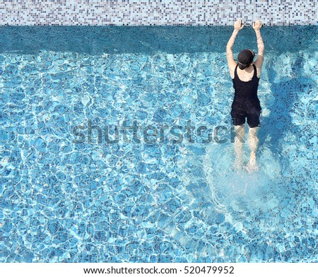 Girl relaxing in the pool with copy space.