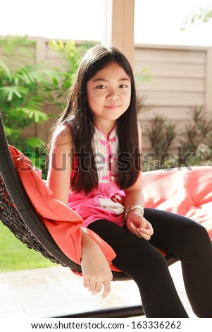 girl relaxing on a cradle - stock photo