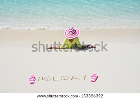 Girl relaxing on the beach of Exuma, Bahamas  - stock photo
