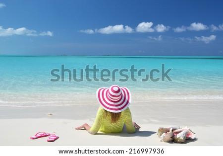 Girl relaxing on the beach of Exuma, Bahamas - stock photo