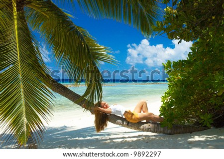 girl relaxing on the palm
