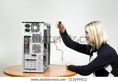 girl repairing the system unit - stock photo