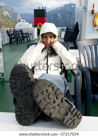 Girl resting during the cruise along the Sognefjord in Norway - stock photo