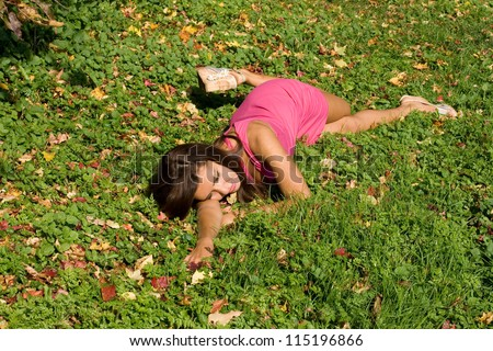 Girl resting on grass in autumn park