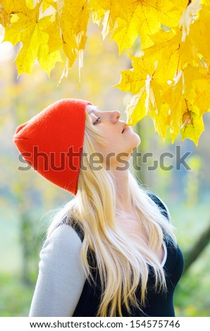 Girl resting on the nature in autumn forest - stock photo