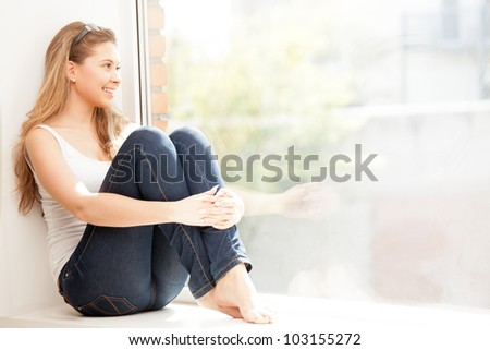Girl resting on the window - stock photo