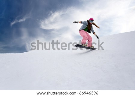 Girl rider jump on snowboard - stock photo