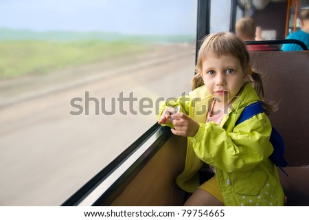 Girl riding on a bus near the window - stock photo