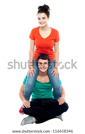 Girl riding on her boyfriend's shoulder. Both having fun - stock photo