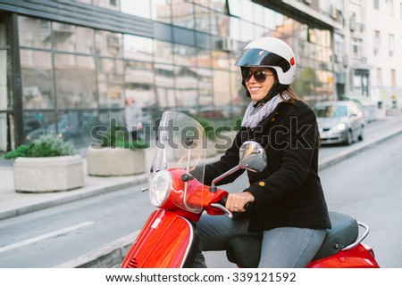 Girl riding retro scooter - stock photo