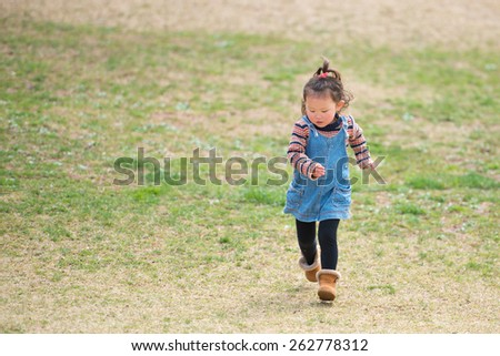Girl running a lawn - stock photo