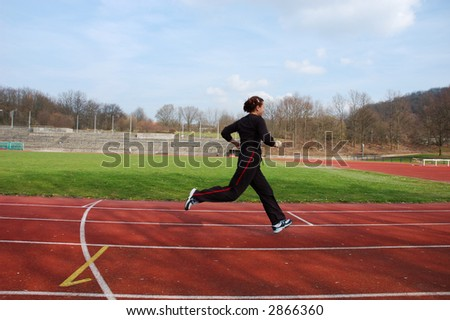 Girl Running in a Stadium