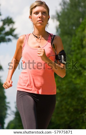 Girl running in the park. Active woman running. A confident female runner has the stamina to conquer all.