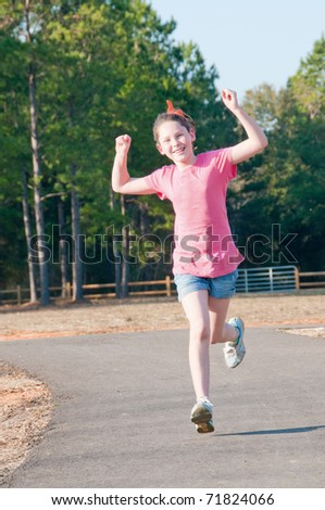 girl running on fitness trail - stock photo