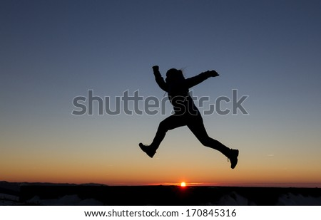 girl runs in sunset