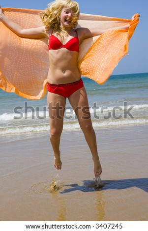 Girl runs on beach