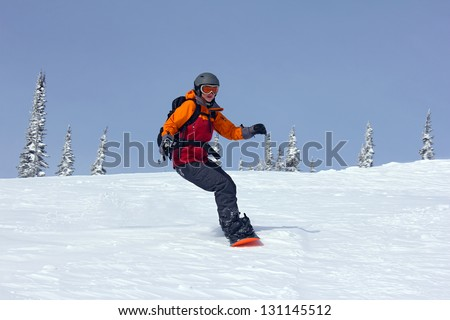girl rushes down the slope on a snowboard, Russia, Sheregesh(Kemerovo Region), 2013 - stock photo