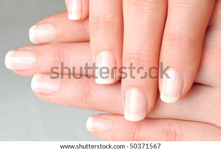 Girl's hands with beautiful nails - stock photo