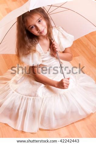Girl's portrait with umbrella - stock photo