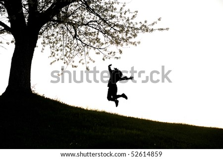 girl's silhouette jumping - stock photo