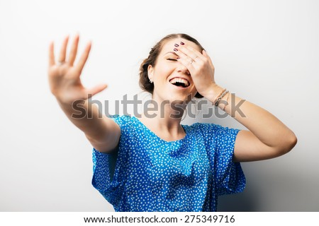 girl says stop and laughs - stock photo