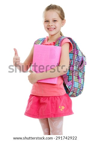 Girl schoolgirl book in hand shows the gesture of the thumb is all right - isolated on white background - stock photo