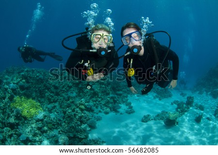 girl scuba divers - stock photo