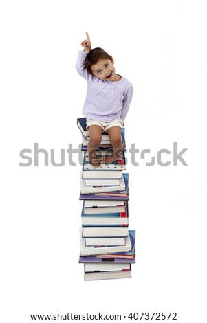 Girl seating on a tall stack of books with smart face isolated on white background - stock photo