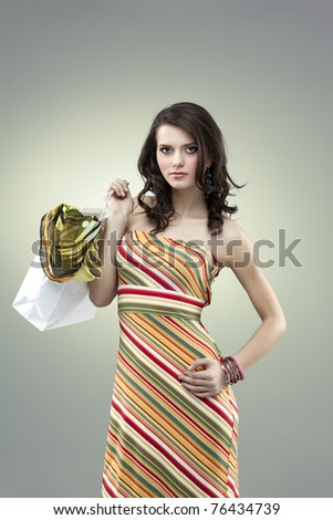 girl seductive stripes dress colors shopping - stock photo