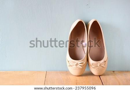girl shoes over wooden deck floor. - stock photo